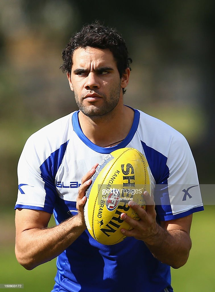 Daniel Wells of the Kangaroos holds the ball during a training session at Aegis Park on August 29, 2012 in Melbourne, Australia.