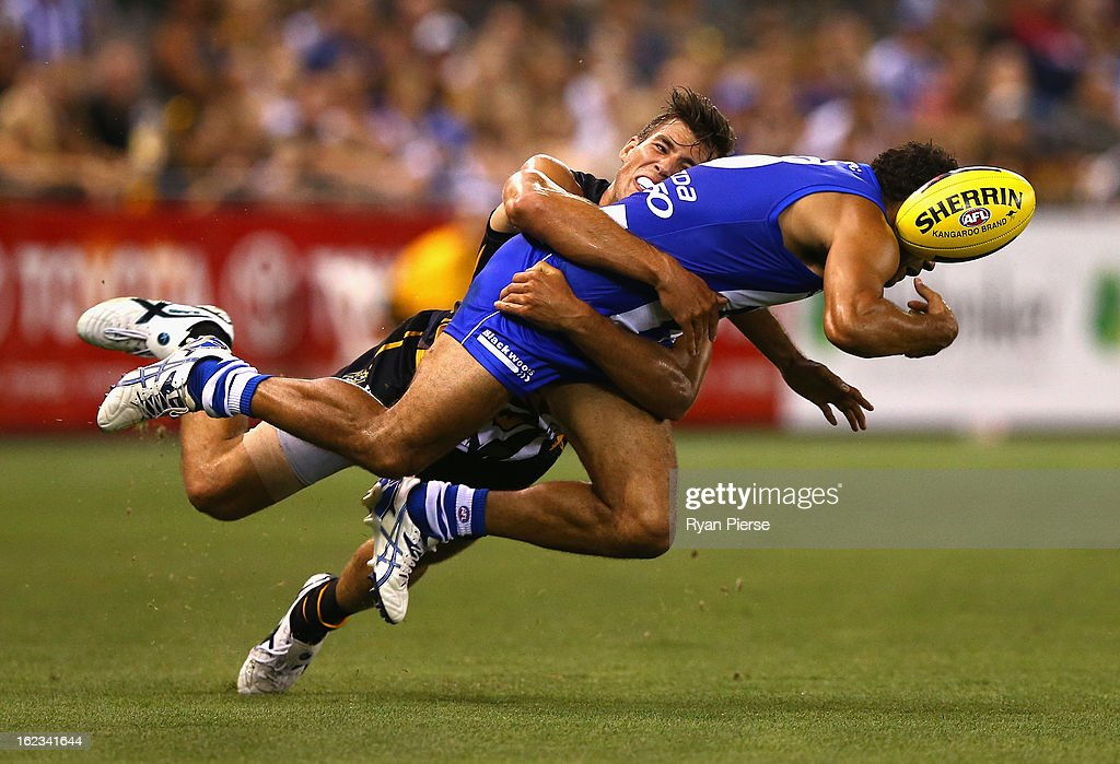 <a gi-track='captionPersonalityLinkClicked' href=/galleries/search?phrase=Daniel+Wells+-+Australian+Rules+Football+Player&family=editorial&specificpeople=213535 ng-click='$event.stopPropagation()'>Daniel Wells</a> of the Kangaroos is tackled by Alex Rance of the Tigers during the round one AFL NAB Cup match between the Richmond Tigers and the the North Melbourne Kangaroos at Etihad Stadium on February 22, 2013 in Melbourne, Australia.