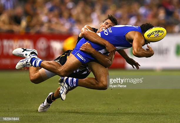 Daniel Wells of the Kangaroos is tackled by Alex Rance of the Tigers during the round one AFL NAB Cup match between the Richmond Tigers and the the...