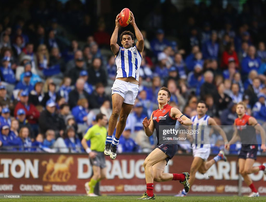 Daniel Wells of the Kangaroos takes a mark during the round 18 AFL match between the Melbourne Demons and the North Melbourne Kangaroos at Etihad Stadium on July 27, 2013 in Melbourne, Australia.