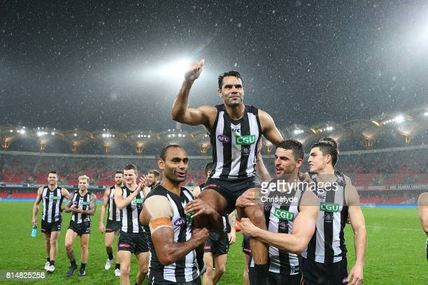 Daniel Wells of the Magpies is chaired from the field after his 250th match during the round 17 AFL match between the Gold Coast Suns and the...