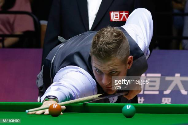 Daniel Wells of Wales plays a shot during his first round match against Judd Trump of England on day two of Evergrande 2017 World Snooker China...