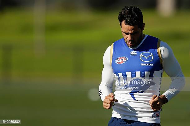 Daniel Wells takes part in running drills during a North Melbourne Kangaroos AFL training session at Arden Street Ground on June 15 2016 in Melbourne...