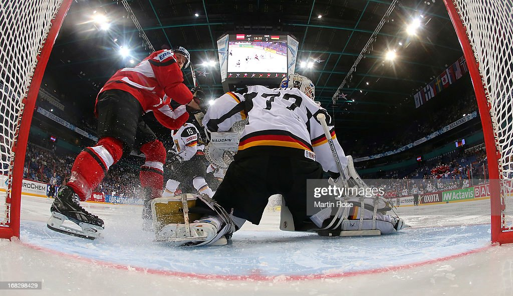 Daniel Welser (L) of Austria fails to score over <a gi-track='captionPersonalityLinkClicked' href=/galleries/search?phrase=Rob+Zepp&family=editorial&specificpeople=3121630 ng-click='$event.stopPropagation()'>Rob Zepp</a> (R), goaltender of Germany during the IIHF World Championship group H match between Austria and Germany at Hartwall Areena on May 8, 2013 in Helsinki, Finland.