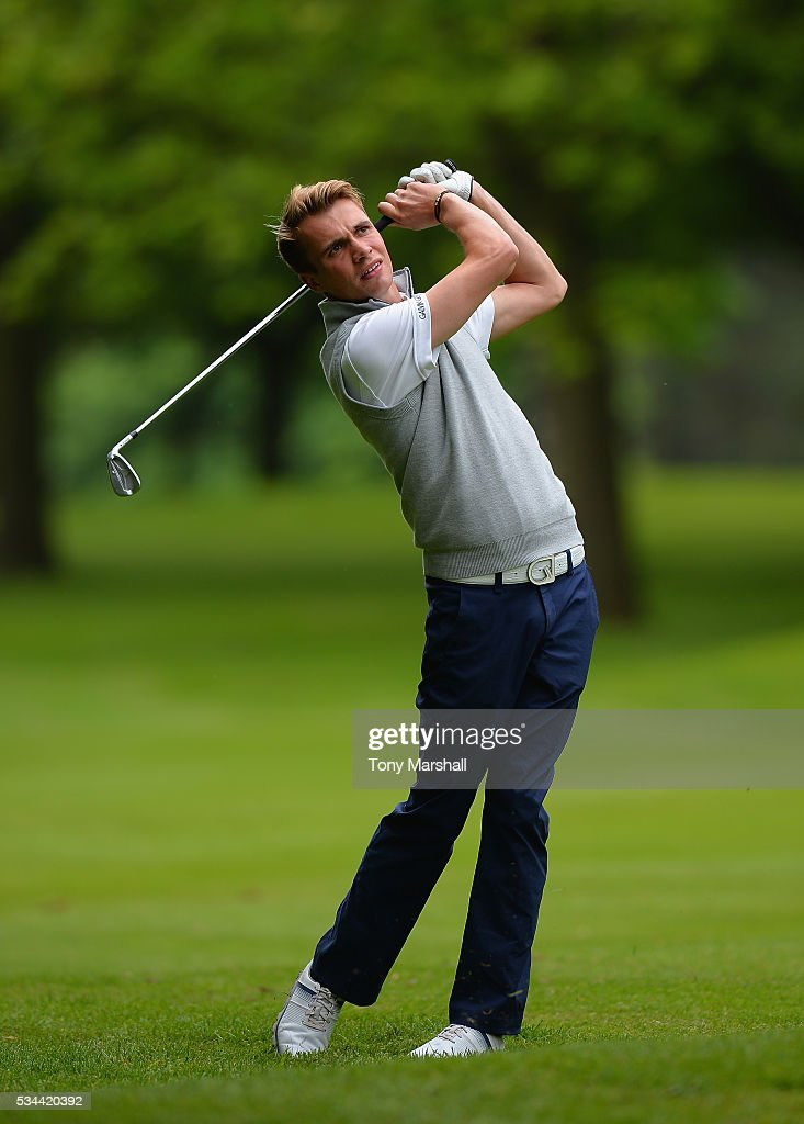 Daniel Whitby-Smith of Whittington Heath Golf Club plays his second shot on the 18th fairway during the PGA Assistants Championships - Midlands Qualifier at the Coventry Golf Club on May 26, 2016 in Coventry, England.