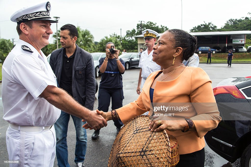 Daniel Willemot, head of the prison of Remire-Montjoly welcomes French Justice minister Christiane Taubira as she arrives for a visit on February 25, 2013, in the French overseas territory of Guiana. AFP PHOTO JODY AMIET
