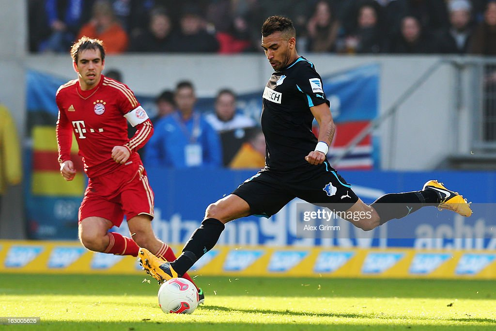 Daniel Williams (front) of Hoffenheim is challenged by <a gi-track='captionPersonalityLinkClicked' href=/galleries/search?phrase=Philipp+Lahm&family=editorial&specificpeople=483746 ng-click='$event.stopPropagation()'>Philipp Lahm</a> of Muenchen during the Bundesliga match between TSG 1899 Hoffenheim and FC Bayern Muenchen at Rhein-Neckar-Arena on March 3, 2013 in Sinsheim, Germany.