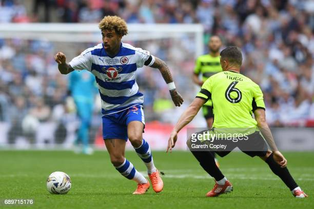 Daniel Williams of Reading attempts to take the ball past Jonathan Hogg of Huddersfield Town during the Sky Bet Championship play off final between...