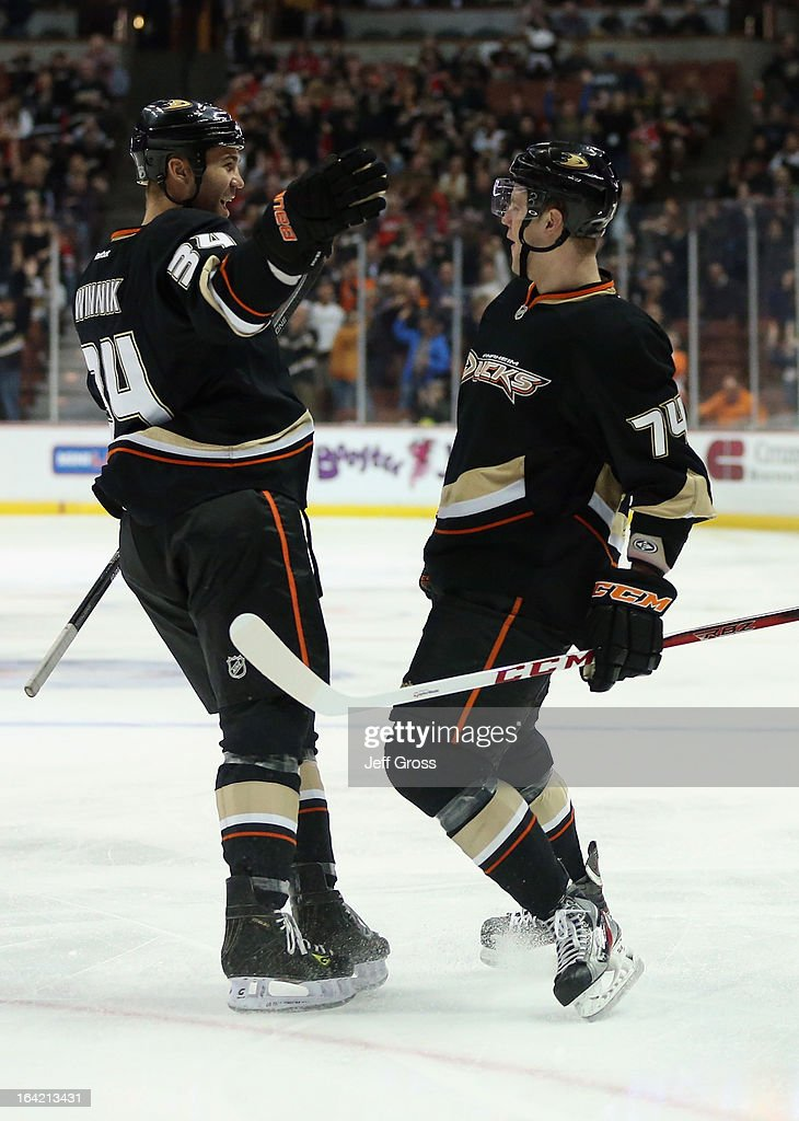 Daniel Winnik (L) #34 and Peter Holland #74 of the Anaheim Ducks celebrate Holland's first period goal against the Chicago Blackhawks at Honda Center on March 20, 2013 in Anaheim, California.