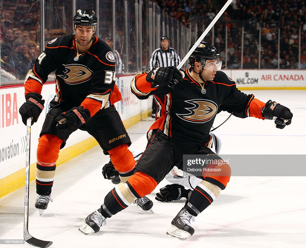 Daniel Winnik #34 and Andrew Cogliano #7 of the Anaheim Ducks skate during the game against the Los Angeles Kings on February 2, 2013 at Honda Center in Anaheim, California.