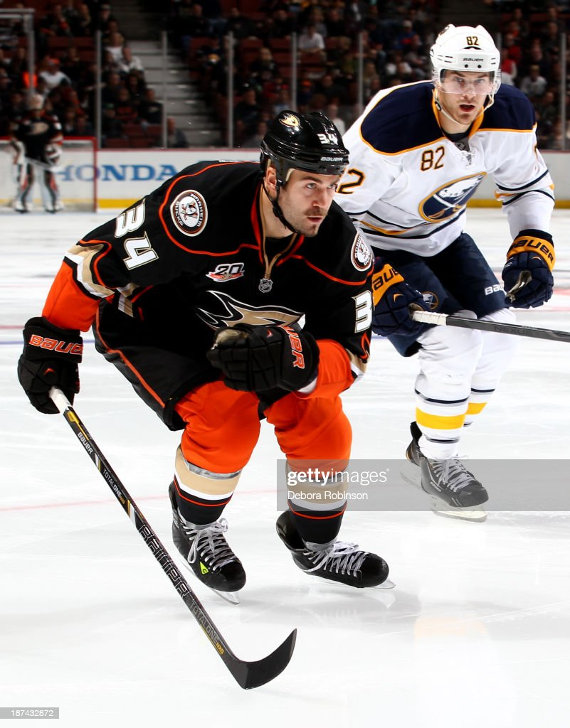 <a gi-track='captionPersonalityLinkClicked' href=/galleries/search?phrase=Daniel+Winnik&family=editorial&specificpeople=2529214 ng-click='$event.stopPropagation()'>Daniel Winnik</a> #34 of the Anaheim Ducks and <a gi-track='captionPersonalityLinkClicked' href=/galleries/search?phrase=Marcus+Foligno&family=editorial&specificpeople=5662790 ng-click='$event.stopPropagation()'>Marcus Foligno</a> #82 of the Buffalo Sabres during a game at Honda Center on November 8, 2013 in Anaheim, California.