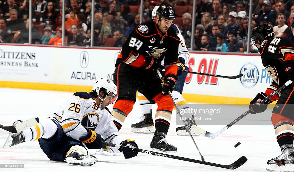 <a gi-track='captionPersonalityLinkClicked' href=/galleries/search?phrase=Daniel+Winnik&family=editorial&specificpeople=2529214 ng-click='$event.stopPropagation()'>Daniel Winnik</a> #34 of the Anaheim Ducks and <a gi-track='captionPersonalityLinkClicked' href=/galleries/search?phrase=Matt+Moulson&family=editorial&specificpeople=3365493 ng-click='$event.stopPropagation()'>Matt Moulson</a> #26 of the Buffalo Sabres fight for procession of the puck during a game at Honda Center on November 8, 2013 in Anaheim, California.