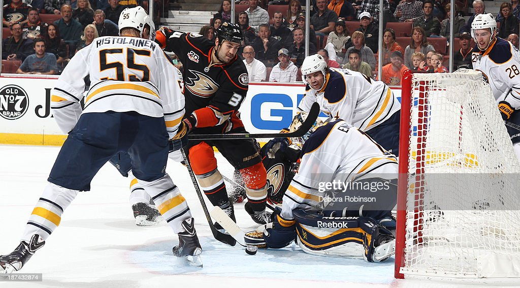 <a gi-track='captionPersonalityLinkClicked' href=/galleries/search?phrase=Daniel+Winnik&family=editorial&specificpeople=2529214 ng-click='$event.stopPropagation()'>Daniel Winnik</a> #34 of the Anaheim Ducks attempts a shot during a game against the Buffalo Sabres at Honda Center on November 8, 2013 in Anaheim, California.