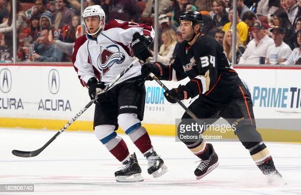 Daniel Winnik of the Anaheim Ducks battles for position against Aaron Palushaj of the Colorado Avalanche on February 24 2013 at Honda Center in...