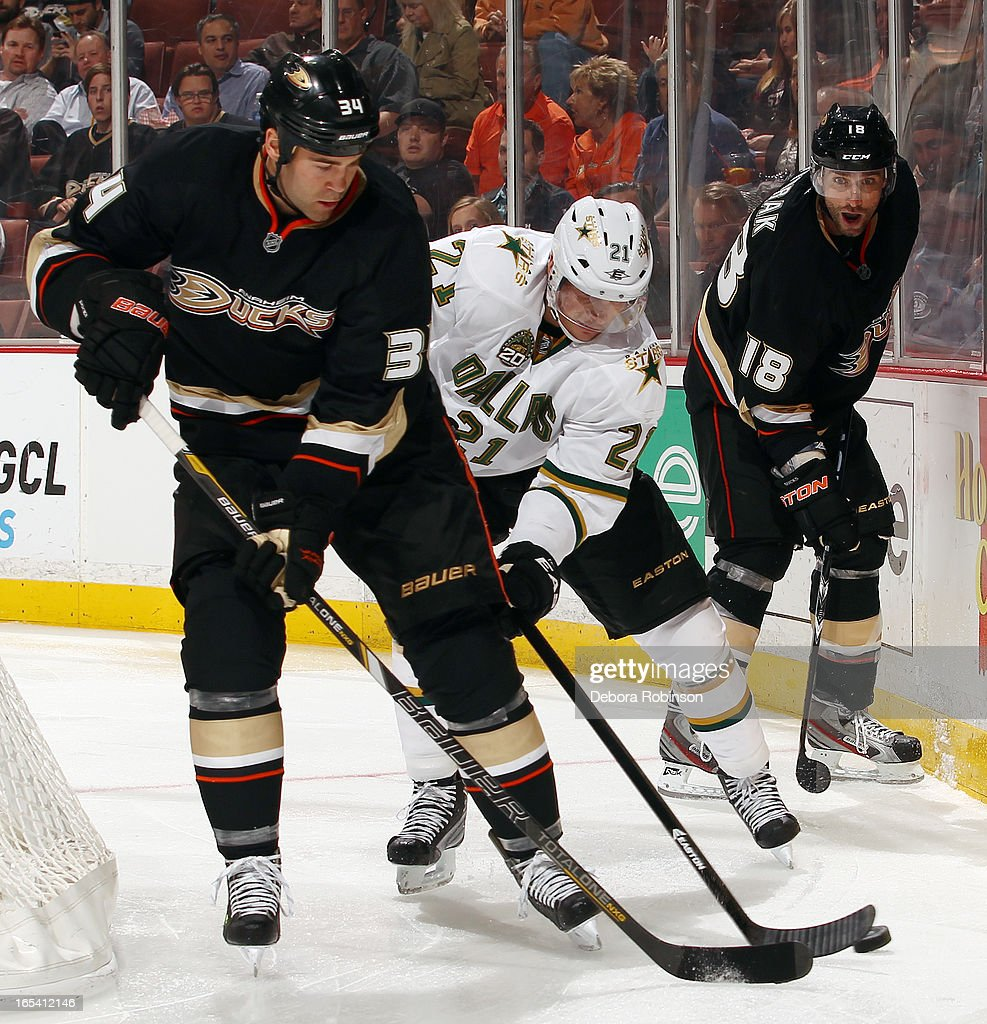 Daniel Winnik #34 of the Anaheim Ducks battles for the puck against Loui Eriksson #21 of the Dallas Stars on April 3, 2013 at Honda Center in Anaheim, California.