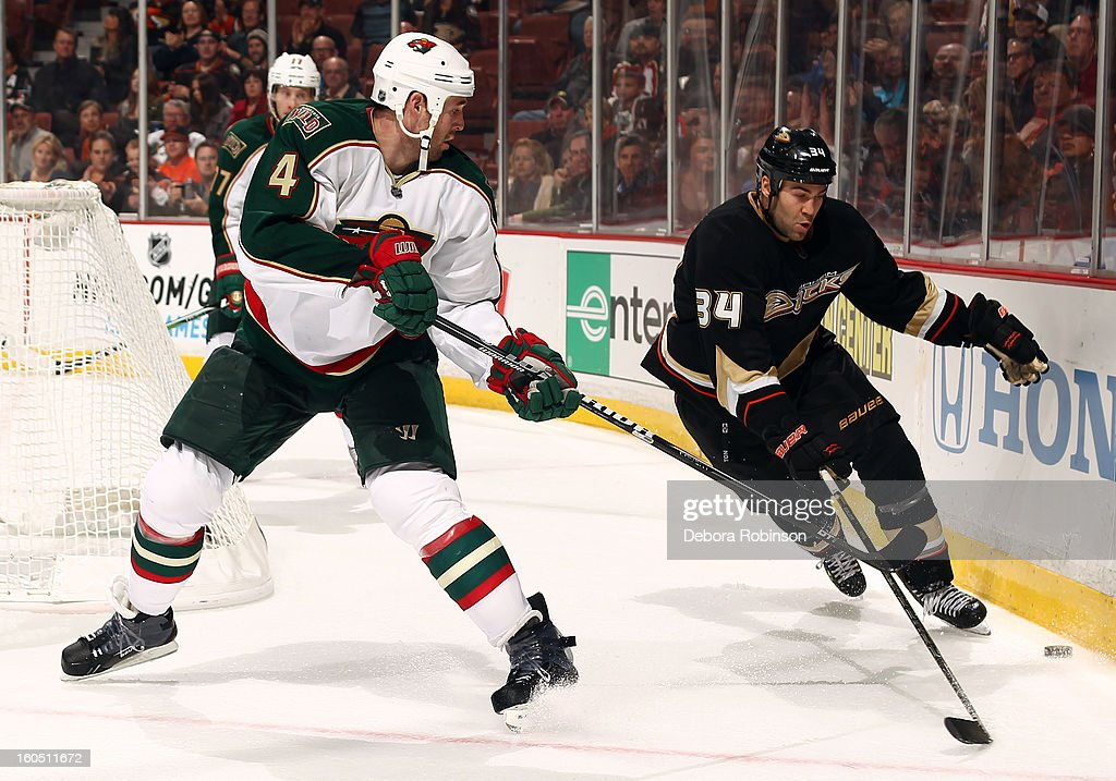 <a gi-track='captionPersonalityLinkClicked' href=/galleries/search?phrase=Daniel+Winnik&family=editorial&specificpeople=2529214 ng-click='$event.stopPropagation()'>Daniel Winnik</a> #34 of the Anaheim Ducks battles for the puck against <a gi-track='captionPersonalityLinkClicked' href=/galleries/search?phrase=Clayton+Stoner&family=editorial&specificpeople=2222214 ng-click='$event.stopPropagation()'>Clayton Stoner</a> #4 of the Minnesota Wild on February 1, 2013 at Honda Center in Anaheim, California.