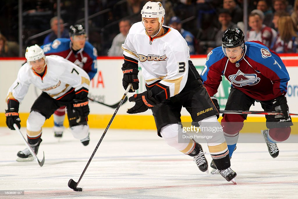 Daniel Winnik #34 of the Anaheim Ducks controls the puck against the Colorado Avalanche at the Pepsi Center on February 6, 2013 in Denver, Colorado. The Ducks defeated the Avalanche 3-0.
