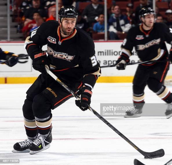 Daniel Winnik of the Anaheim Ducks handles the puck against the Nashville Predators on April 4 2014 at Honda Center in Anaheim California
