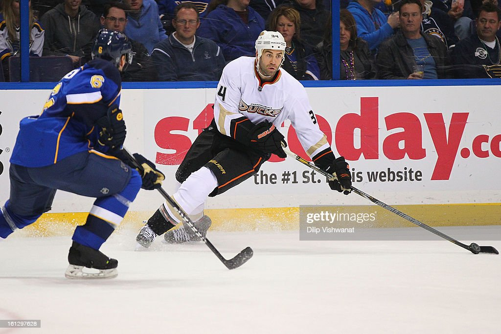 <a gi-track='captionPersonalityLinkClicked' href=/galleries/search?phrase=Daniel+Winnik&family=editorial&specificpeople=2529214 ng-click='$event.stopPropagation()'>Daniel Winnik</a> #34 of the Anaheim Ducks looks to pass the puck against the St. Louis Blues at the Scottrade Center on February 9, 2013 in St. Louis, Missouri.