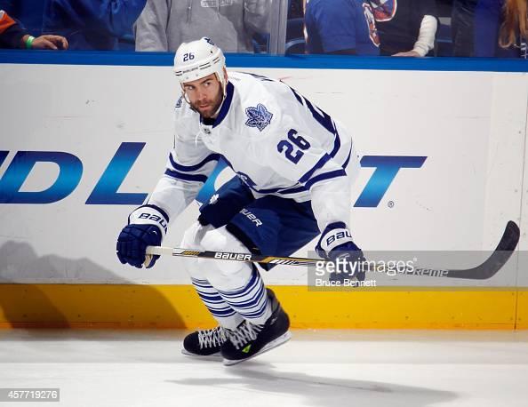 Daniel Winnik of the Toronto Maple Leafs skates against the New York Islanders at the Nassau Veterans Memorial Coliseum on October 21 2014 in...