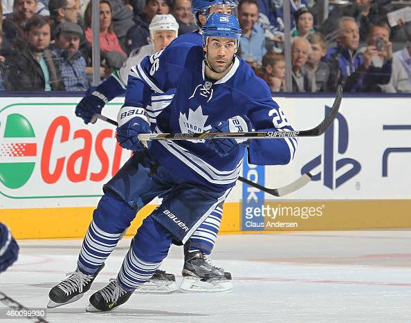 Daniel Winnik of the Toronto Maple Leafs skates against the Vancouver Canucks during an NHL game at the Air Canada Centre on December 6 2014 in...