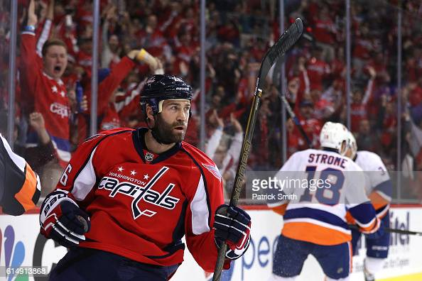 Daniel Winnik of the Washington Capitals celebrates after scoring his second goal of the game against the New York Islanders in the second period at...