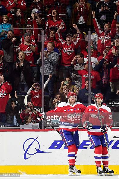 Daniel Winnik of the Washington Capitals celebrates his second period goal with his teammate Tom Wilson during a game against the Nashville Predators...