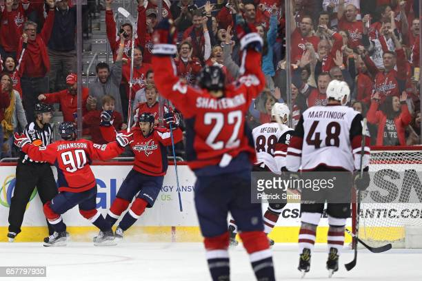 Daniel Winnik of the Washington Capitals celebrates with Marcus Johansson after scoring his first goal of the third period against the Arizona...