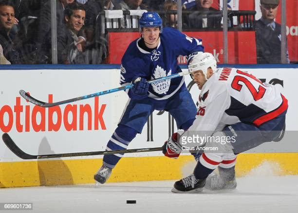 Daniel Winnik of the Washington Capitals fails to stop Mitchell Marner of the Toronto Maple Leafs from making a pass in Game Three of the Eastern...