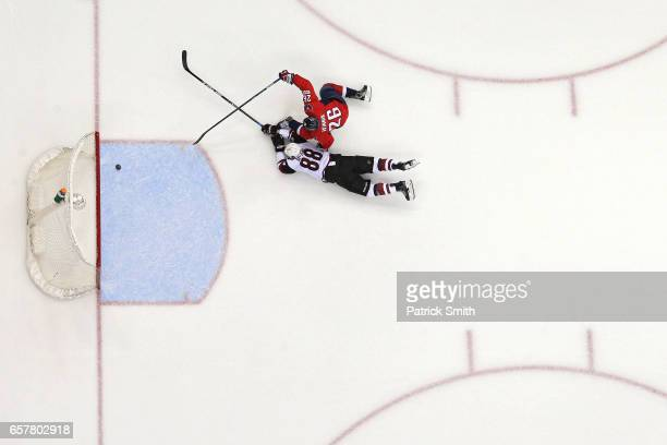 Daniel Winnik of the Washington Capitals scores an empty net goal in front of Jamie McGinn of the Arizona Coyotes during the third period at Verizon...