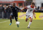 Daniel Woolard of the DC United and Marvin Chavez of the San Jose Earthquakes go for the ball at Buck Shaw Stadium on May 2 2012 in Santa Clara...