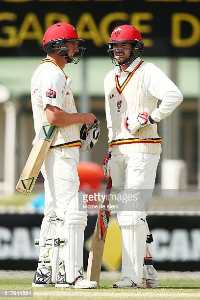 Daniel Worrall and Chadd Sayers of the Redbacks speak between overs during day 4 of the Sheffield Shield Final match between South Australia and...
