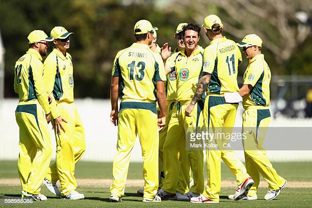 Daniel Worrall of Australia A celebrates with his team mates after taking the wicket of Karun Nair of India A during the Cricket Australia Winter...