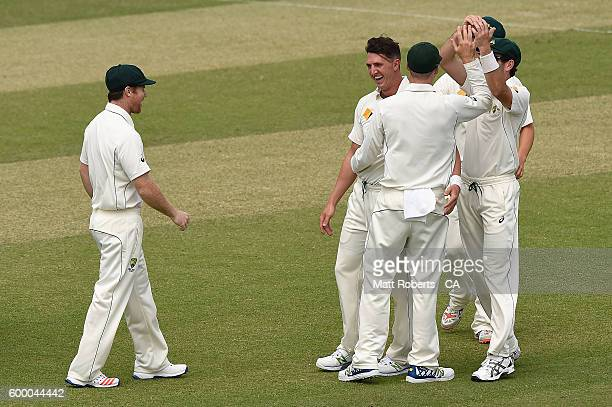 Daniel Worrall of Australia A celebrates with team mates the wicket of Akhil Herwadkar India A during the Cricket Australia Winter Series match...