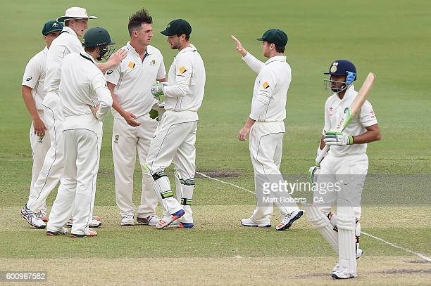 Daniel Worrall of Australia A celebrates with team mates the wicket of Faiz Fazal of India A during the Cricket Australia Winter Series match between...