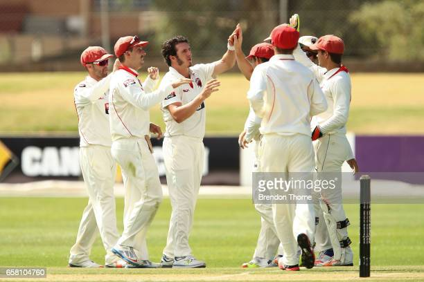 Daniel Worrall of the Redbacks celebrates with team mates after claiming the wicket of Dan Christian of the Bushrangers during the Sheffield Shield...