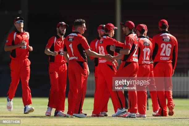 Daniel Worrall of the Redbacks celebrates with team mates after taking the wicket of Matt Short of the Bushrangers during the JLT One Day Cup match...