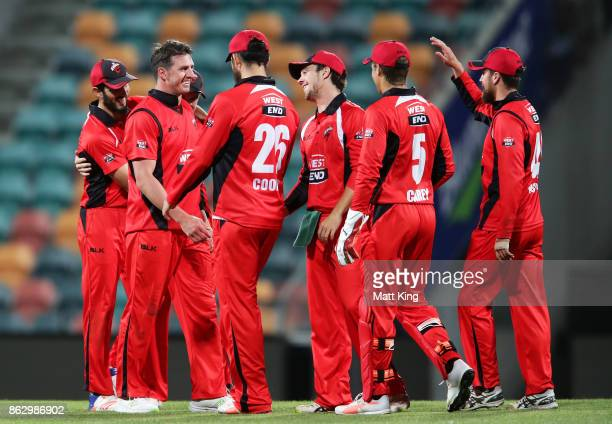 Daniel Worrall of the Redbacks celebrates with team mates after taking the wicket of Dan Christian of the Bushrangers during the JLT One Day Cup...
