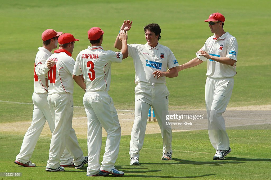 Daniel Worrall of the Redbacks celebrates with teammates after he got a wicket during day three of the Sheffield Shield match between the South Australian Redbacks and the New South Wales Blues at Adelaide Oval on February 21, 2013 in Adelaide, Australia.