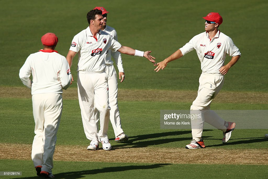 Daniel Worrall of the Redbacks celebrates with teammates after getting the wicket of Marcus Stoinis of the VIC Bushrangers during day one of the Sheffield Shield match between South Australia and Victoria at Adelaide Oval on February 14, 2016 in Adelaide, Australia.