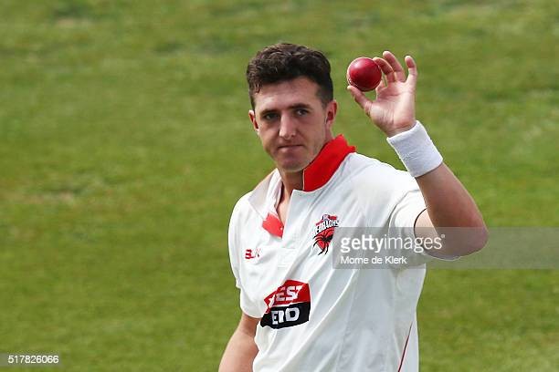 Daniel Worrall of the Redbacks holds up the ball to the crowd during day 3 of the Sheffield Shield Final match between South Australia and Victoria...