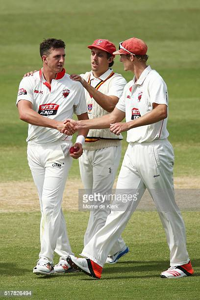 Daniel Worrall of the Redbacks is congratulated by teammates after getting the wicket of Cameron White of the VIC Bushrangers during day 3 of the...