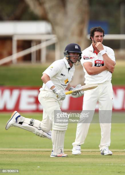 Daniel Worrall of the Redbacks reacts after being hit for runs as Marcus Harris of the Bushrangers runs between wickets during the Sheffield Shield...
