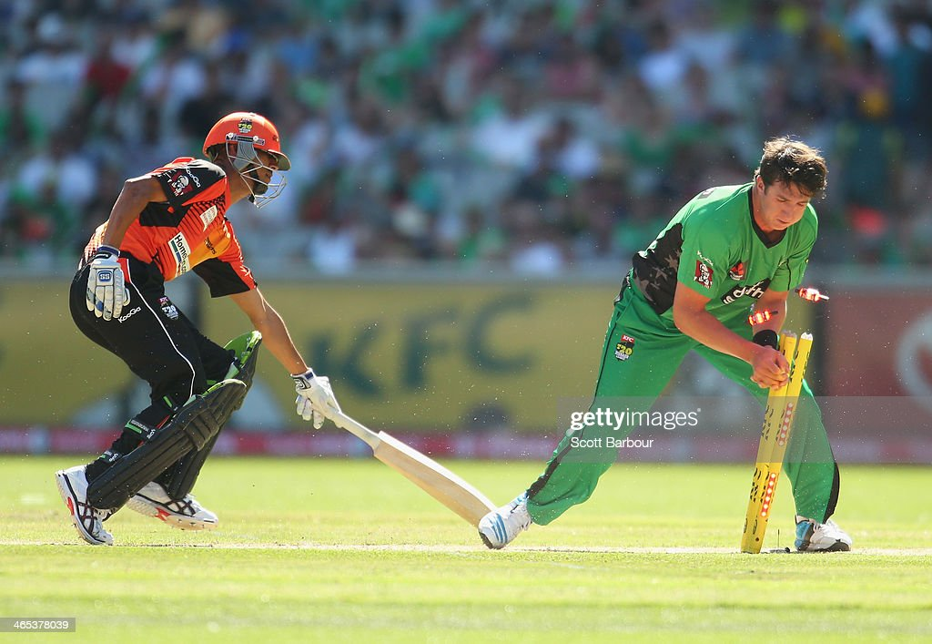 Daniel Worrall of the Stars unsuccessfully attempts to run out Daniel Worrall of the Scorchers during the Big Bash League match between the Melbourne Stars and the Perth Scorchers at Melbourne Cricket Ground on January 27, 2014 in Melbourne, Australia.