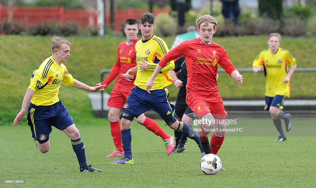 Daniel Wright (L) and Ethan Robson of Sunderland watch Will Marsh of Liverpool during the Barclays Premier League Under 18 fixture between Liverpool and Sunderland at the Liverpool FC Academy on February 15 in Kirkby, England.
