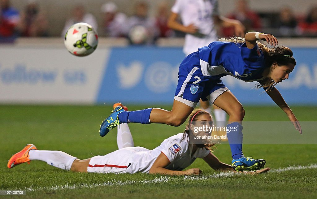 Daniela Andrade #2 of Guatemala jumps over Alex Morgan #13 of the United States after blocking a shot during the 2014 CONCACAF Women's Championship at Toyota Park on October 17, 2014 in Bridgeview, Illinois. The United States defeated Guatemala 5-0.