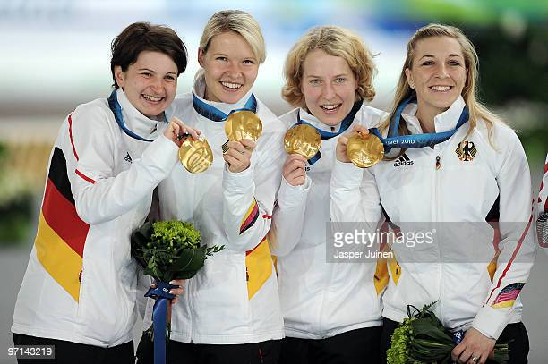 Daniela Anschutz Thoms Stephanie Beckert Katrin Mattscherodt and Anni FriesingerPostma of Germany celebrate winning the gold medal during the medal...