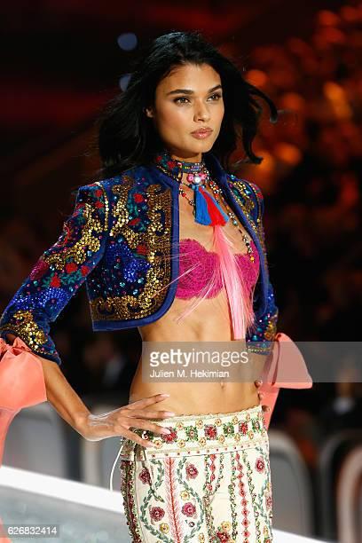 Daniela Braga walks the runway with Swarovski crystals during Victoria's Secret Fashion Show on November 30 2016 in Paris France