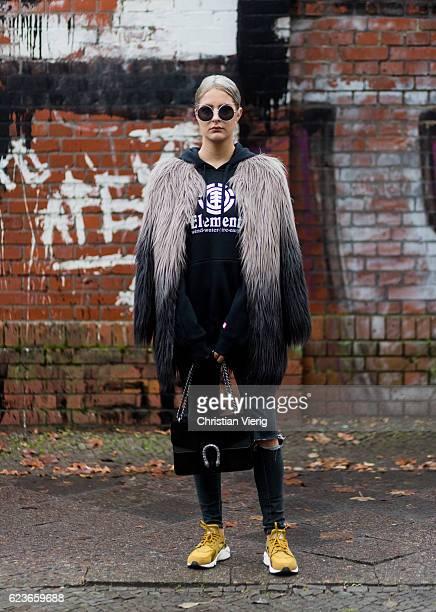 Daniela Breithaupt wearing Nike sneaker black hoody Element fake fur coat Unreal Fur black ripped denim jeans Primark sunglasses Zaful black Gucci...