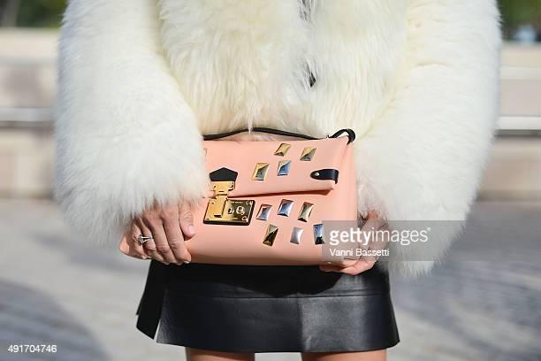 Daniela Carmichael poses wearing Louis Vuitton after the Louis Vuitton show at the Fondation Louis Vuitton during Paris Fashion Week SS16 on October...